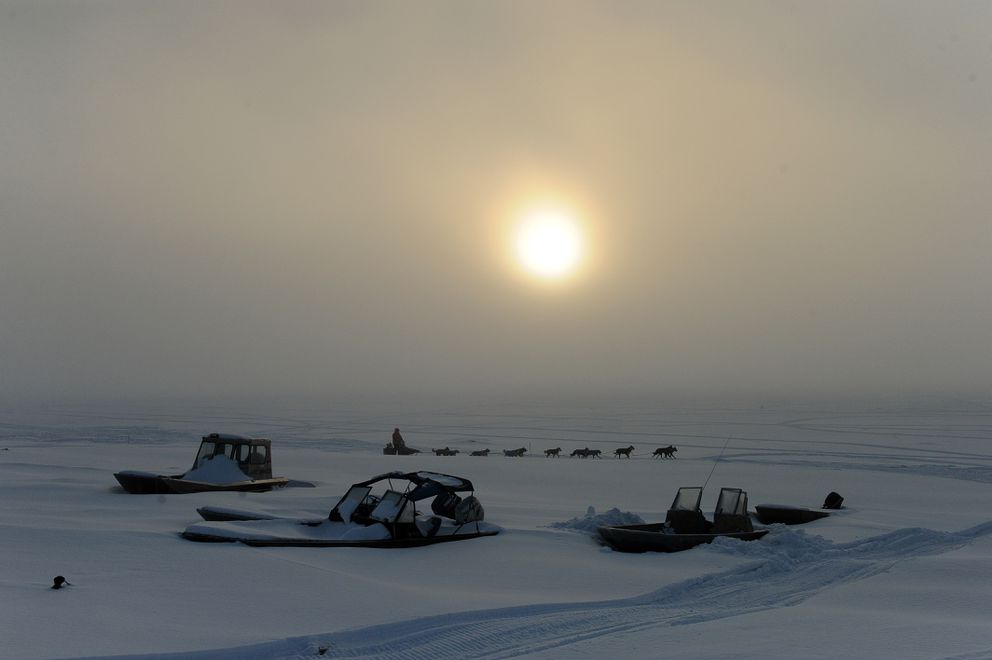 Iditarod musher Ryan Redington arrives at the Nulato checkpoint as the sun breaks through a fog bank Sunday. (Bob Hallinen / Alaska Dispatch News)