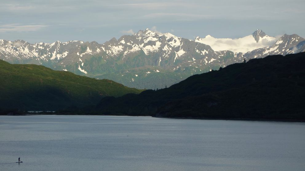 A paddleboarder on Shoup Bay, Alaska, which is home to a few banana slugs. (Photos by Ned Rozell)