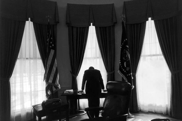 President John F. Kennedy in the Oval Office of the White House in Washington, Feb. 19, 1961. Though the Cuban Missile Crisis took place over a year later, the image has become an iconic representation of what has been characterized as the loneliest job in the world. This October, 2012, marks the 50th anniversary of the confrontation between the U.S. and the Soviet Union over their positioning of nuclear missiles in Cuba. (George Tames/The New York Times)