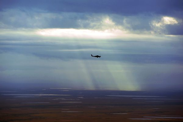Patchy showers and sunshine mottle the Western Alaska tundra as a commuter flight heads west out of Bethel on Thursday, August 28, 2014, in Southwest Alaska. (Erik Hill / ADN)