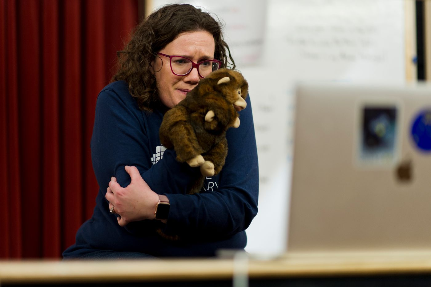 Loussac Library children's librarian Elizabeth Nicolai streams a bedtime story session with help from a puppet on March 24, 2020. (Marc Lester / ADN)
