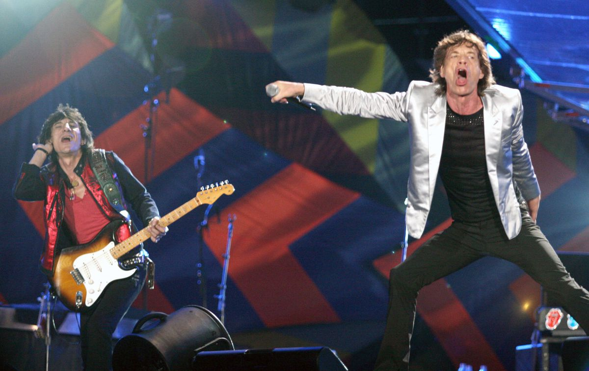 Mick Jagger, right and Ron Wood perform during a Rolling Stones concert in Rio de Janeiro, Brazil, in 2006. (Bloomberg photo by Douglas Engle)