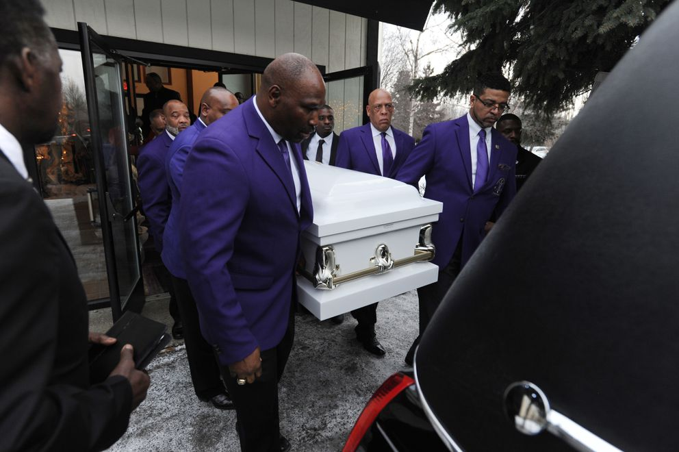 Pallbearers carry the casket of Bettye Davis after the funeral service at Shiloh Missionary Baptist Church. (Bill Roth / ADN)