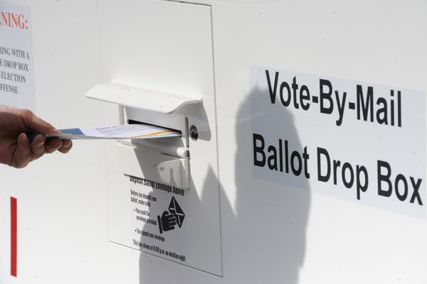 A ballot is placed in a secure Vote-By-Mail Ballot Drop Box at the Loussac Library on Monday, April 6, 2020. Tuesday is Election Day for the Regular Municipal Election. (Bill Roth / ADN)