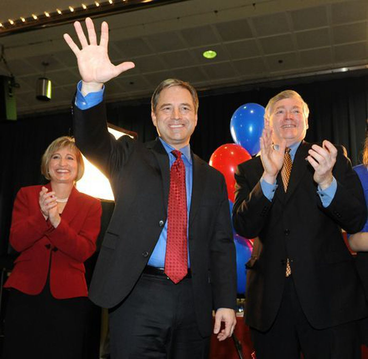 Gov. Sean Parnell thanks supporters flanked by his wife Sandy, left, and his running mate Mead Treadwell at election central Tuesday evening November 2, 2010 at the Egan Center downtown.