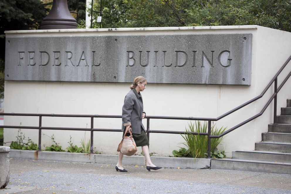 "Alice Rogoff, former owner of Alaska Dispatch News, walks toward the Old Federal Building downtown before the start of a bankruptcy hearing earlier this month. Some creditors have said they may attempt to ""pierce the corporate veil"" to make Rogoff personally liable for some debts, rather than ADN. (Rugile Kaladyte / Alaska Dispatch News)"