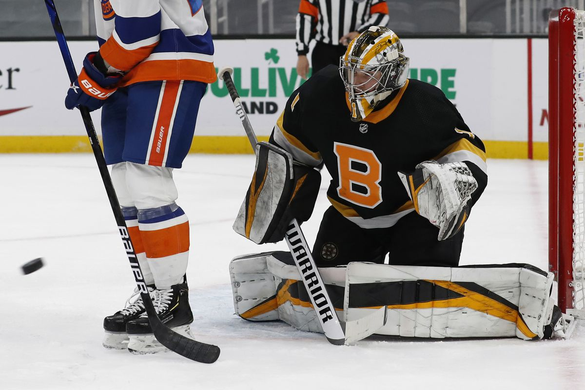 Boston Bruins goaltender Jeremy Swayman of Anchorage tracks a shot during his first NHL shutout Friday night. (Winslow Townson / Associated Press)