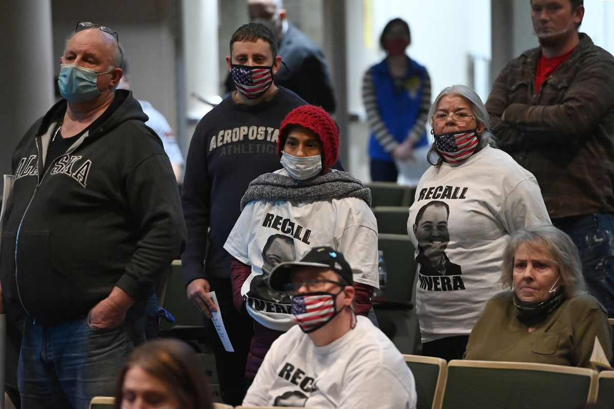 People stand in line to testify during an Anchorage Assembly meeting on Tuesday, Jan. 12, 2021. (Bill Roth / ADN)