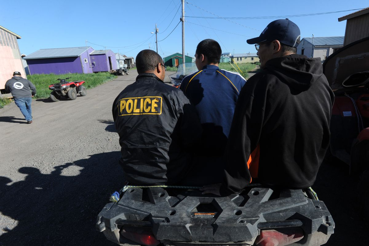 Village police officers leave on a four wheeler after giving public safety reports at a city council meeting in the Yup'ik village of Stebbins on the Norton Sound coast in Western Alaska on Thursday, June 27, 2019. (Bill Roth / ADN)