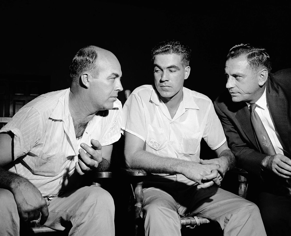 "J. W. Milam, 36, and half-brother Roy Bryant, 24, confer with one of their lawyers J.W. Kellum, right, just before pleding innocent, September 6, 1955 at Sumner, Miss.. They are charged with kidnapping Emmett Till, a 14-year-old black youth who they claim ""made some remarks"" and whistled at Bryant's wife. (AP Photo/Gene Herrick)"