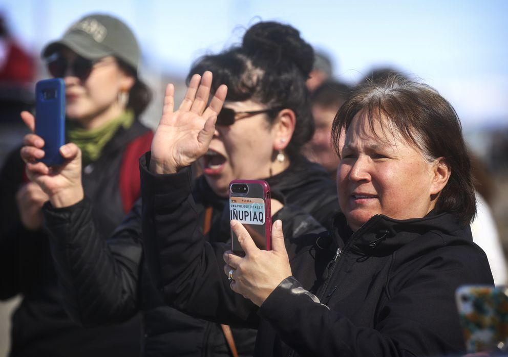 Cindy Fields, middle, and Wanda Baltazar, right, film and cheer on Kotzebue's graduating high school seniors during a senior graduation parade in Kotzebue on Saturday, May 2, 2020. (Photo by Emily Mesner)