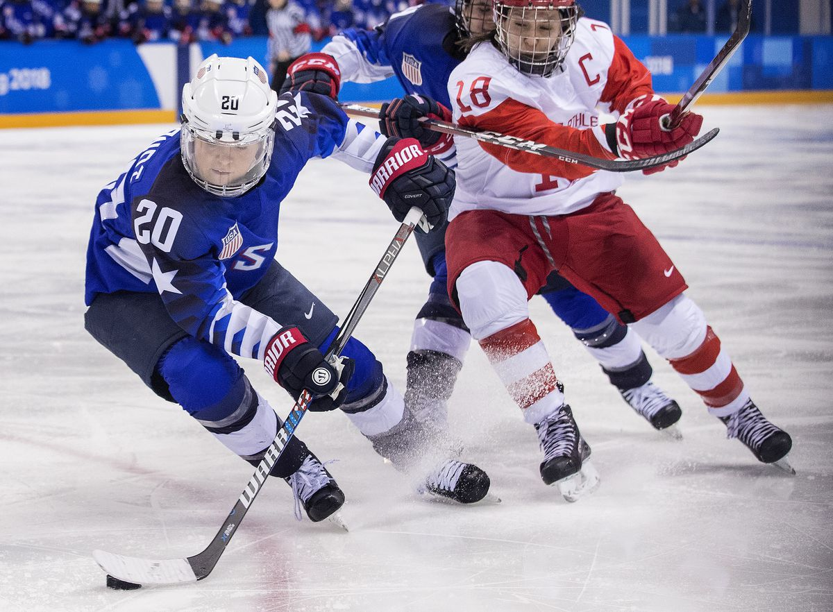 Hockey USA vs. Olympic Athlete from Russia. Hannah Brandt (20) and Diana Kanayeva (28) fought for the puck, on February 13, 2018, in South Korea, during the 2018 Pyeongchang Winter Olympics.