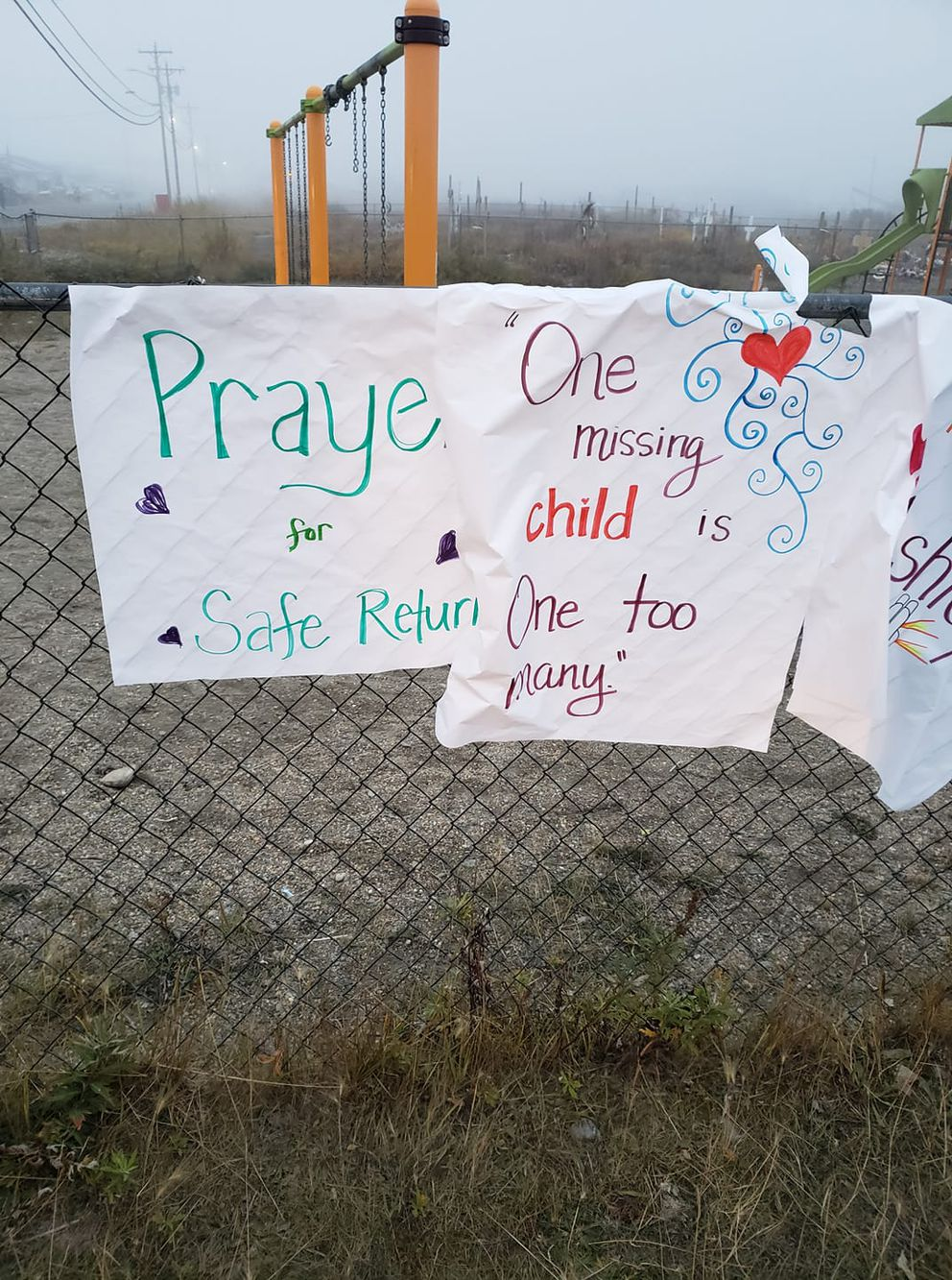 Signs in a Kotzebue park with messages praying for Johnson-Barr's safe return. (Scotty Barr)