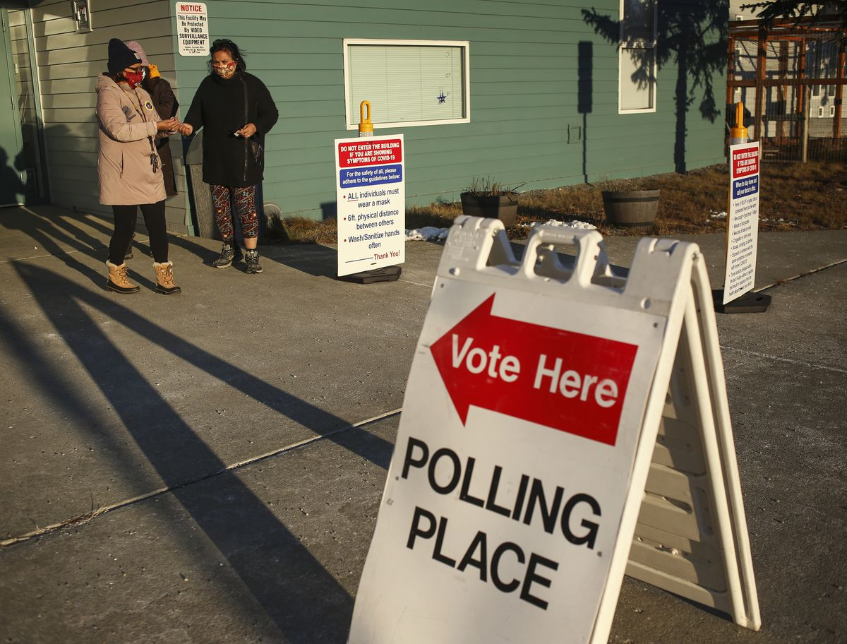 Women exit Williwaw Elementary School, a polling location in East Anchorage, after voting in the general election on Nov. 3, 2020. (Emily Mesner / ADN)
