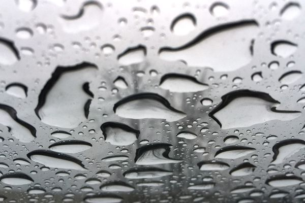 Rain formed water droplets on a sun roof window as low pressure moved through Anchorage on Thursday, Jan. 28, 2016. (Bill Roth / Alaska Dispatch News )