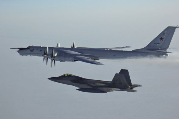 In this Monday, March 9, 2020 photo released by the North American Aerospace Defense Command (NORAD), a Russian Tu-142 maritime reconnaissance aircraft, top right, is intercepted near the Alaska coastline. U.S. and Canadian aircraft intercepted and escorted two Russian jets that flew over the Beaufort Sea near the Alaska coastline, military officials said Tuesday. The Russian Tu-142 maritime reconnaissance aircraft were escorted by F-22 and CF-18 planes, the North American Aerospace Defense Command said in a release. The Russian jets never left international airspace during the duration of the four-hour flight on Monday, but did come within 50 miles of the Alaska coast. (North American Aerospace Defense Command via AP)