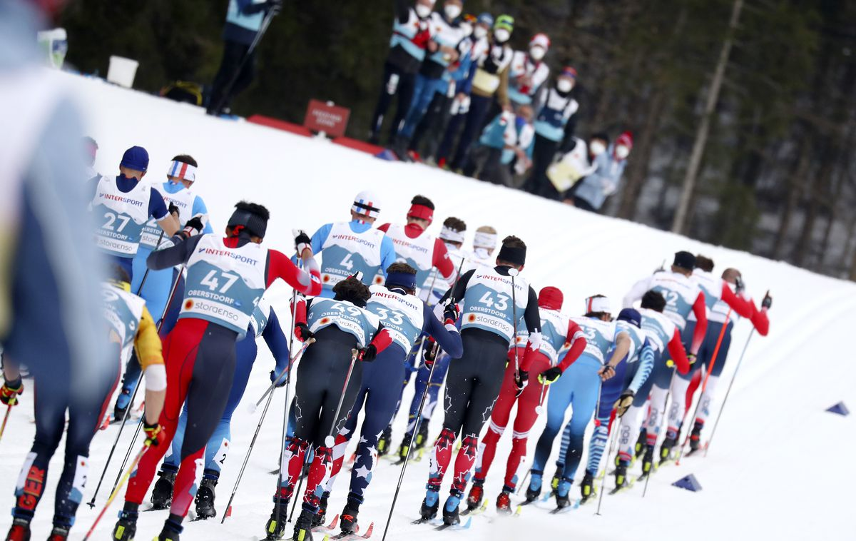 Skiers begin the men's 50-kilometer race Sunday at the World Championships in Oberstdorf, Germany. (AP Photo/Matthias Schrader)