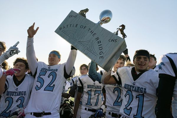 Chugiak players celebrate after winning the