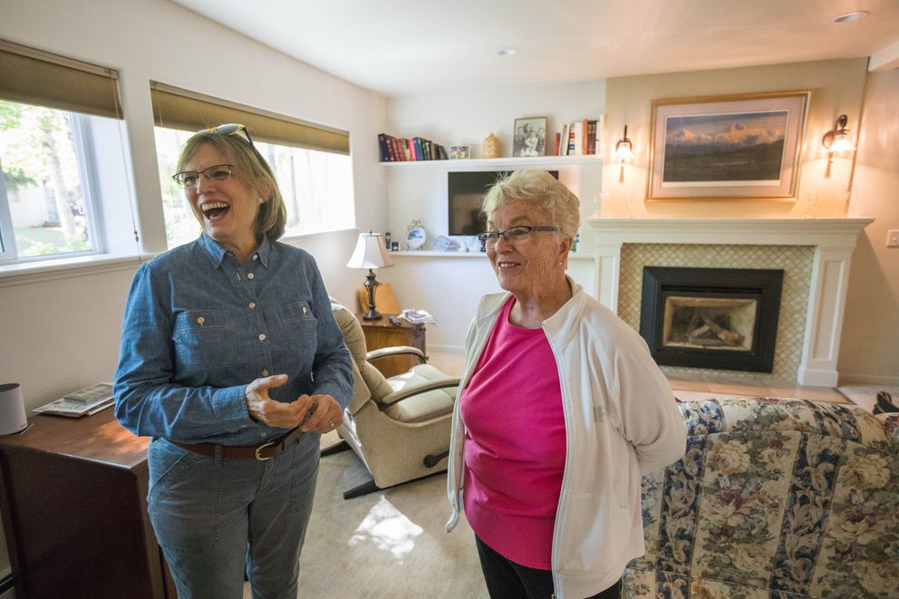 Former Alaska state legislator Alyce Hanley, right, talks with her friend Susan Fison, a former Anchorage planning director, in the apartment Hanley built into the bottom floor of her home in Sand Lake on Thursday, June 7, 2018. Hanley, who is 84, wanted to live with her children but have her own living space. (Loren Holmes / ADN)