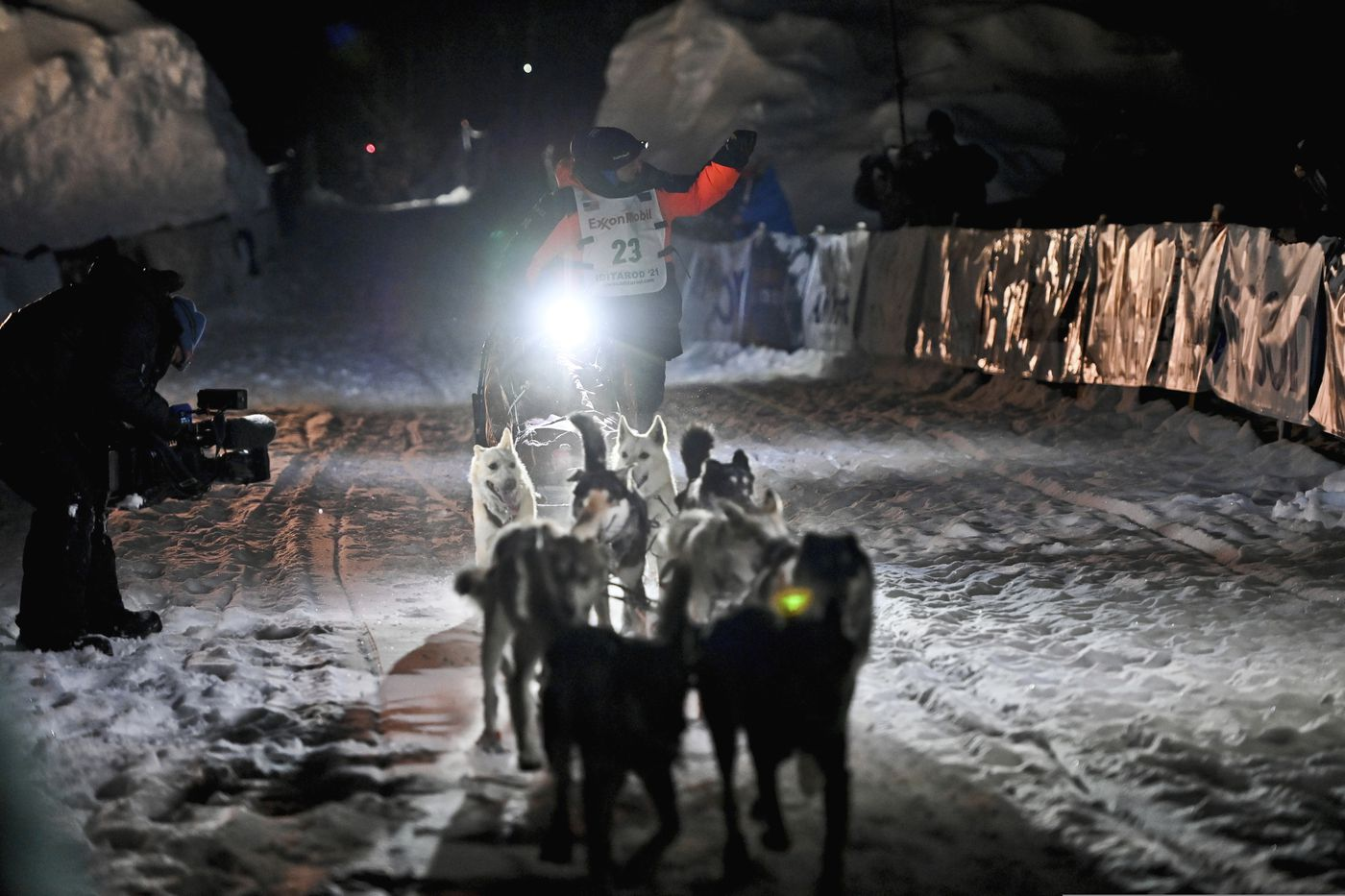 Dallas Seavey's team runs into the chute near the finish line of the Iditarod Trail Sled Dog Race race near Willow early Monday morning. Seavey has won the Iditarod and matched a milestone in the world's most famous sled dog race. It's the fifth title for the 34-year-old Seavey, matching the record of most wins by any musher. (Marc Lester/ADN)