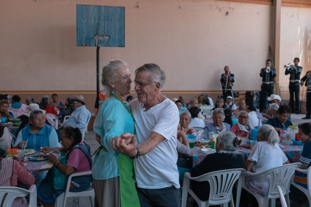 Pamela Gould and Stan Allen dance at a soup kitchen organized by U.S. citizens on the grounds of the parish church of St. Michael the Archangel in San Miguel. Photo for The Washington Post by Luis Antonio Rojas