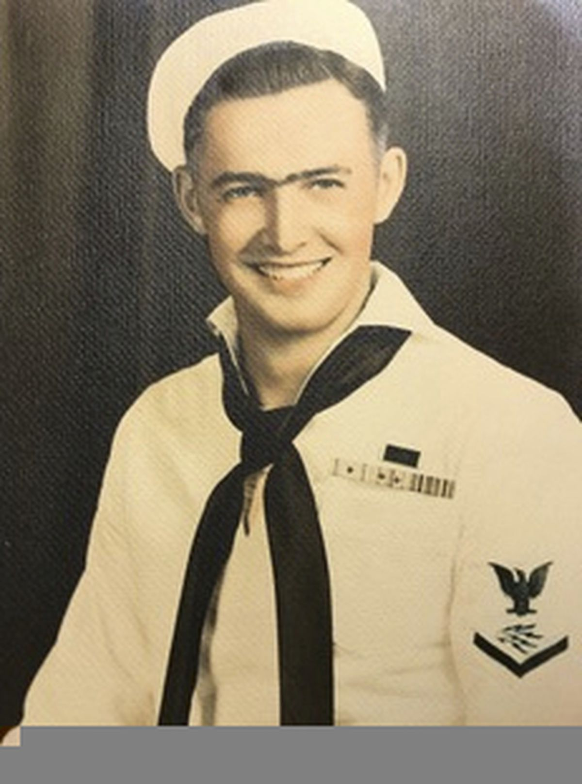 This photo provided by retired U.S. Navy Cmdr. Don Long shows Long in his Navy uniform in 1943. Long wasn't at Pearl Harbor when Japanese warplanes bombed Hawaii on December 7, 1941 - he was on the opposite side of Oahu aboard an anchored seaplane in Kaneohe Bay. But the Japanese strike reached his installation soon after Pearl Harbor, and the young sailor watched from afar as explosions and gunfire consumed him and his comrades. Now, 77 years later, Long will remember that day from even farther away - across the Pacific at his home in Northern California. (Don Long via AP)