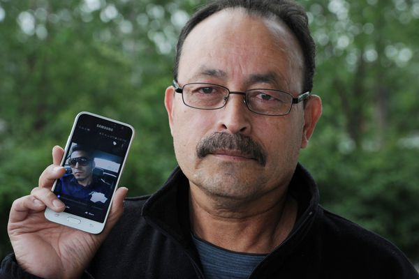 Jorge Rea-Villa, Sr., holds a photo of his oldest son Jorge Rea-Villa after attending the arraignment of Trayvon Morrissette on Tuesday, July 5, 2016, who has been charged with first-degree murder in the shooting death of his son during a barbecue on the Fourth of July. (Bill Roth / Alaska Dispatch News)