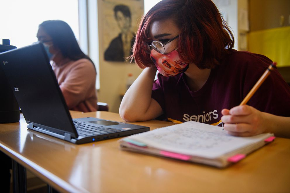 Emerie Randall, who will be a sophomore in fall, works in math class during the summer session at Dimond High School on June 8, 2021. (Marc Lester / ADN)