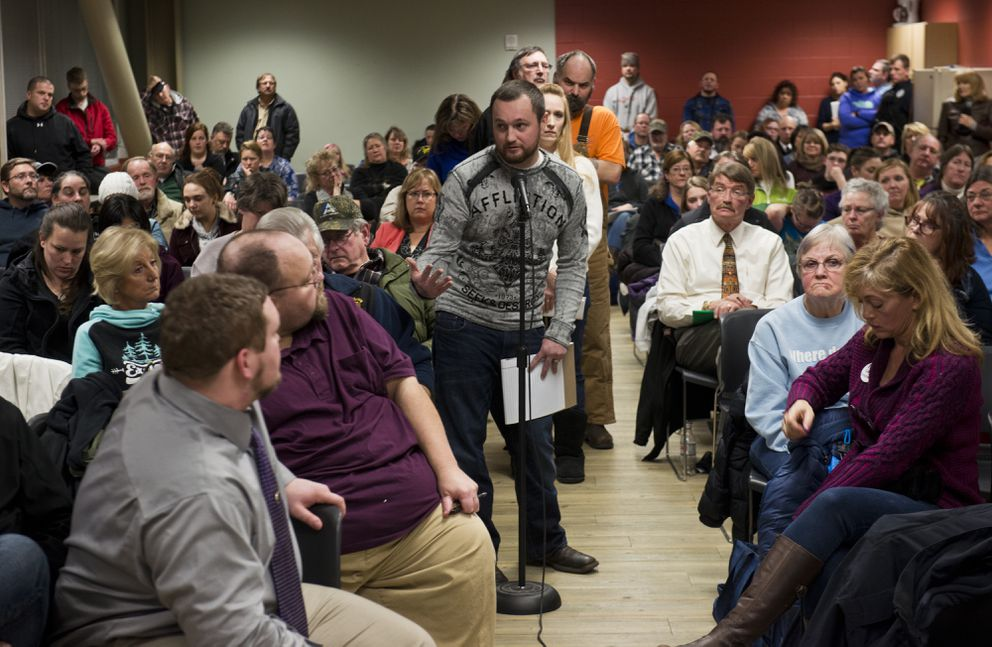 Karl Soderstrom speaks in favor of treating addiction as an illness while also holding criminals accountable. About 150 people filled a meeting room at the Menard Center in Wasilla for a Public Safety Town Hall Meeting with legislators, law enforcement representatives, citizens' groups and others on Wednesday, January 4, 2017. (Marc Lester / Alaska Dispatch News)
