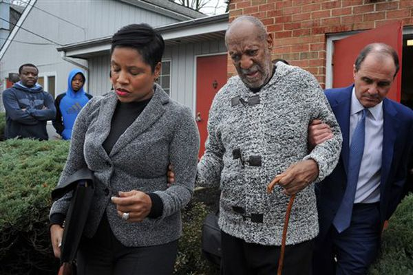 Actor and comedian Bill Cosby is helped as he leaves after a court appearance, Wednesday, Dec. 30, 2015, in Elkins Park, Pa. Cosby was arrested and charged with drugging and sexually assaulting a woman at his home in January 2004.