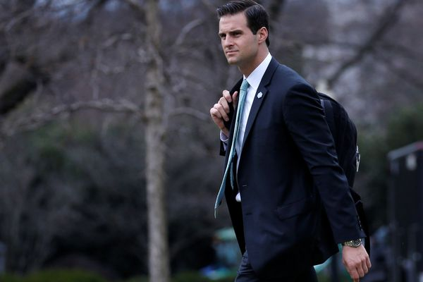 John McEntee walks to Marine One to join U.S. President Donald Trump for travel to Florida in Washington, U.S., February 16, 2018. Picture taken February 16, 2018. REUTERS/Leah Millis