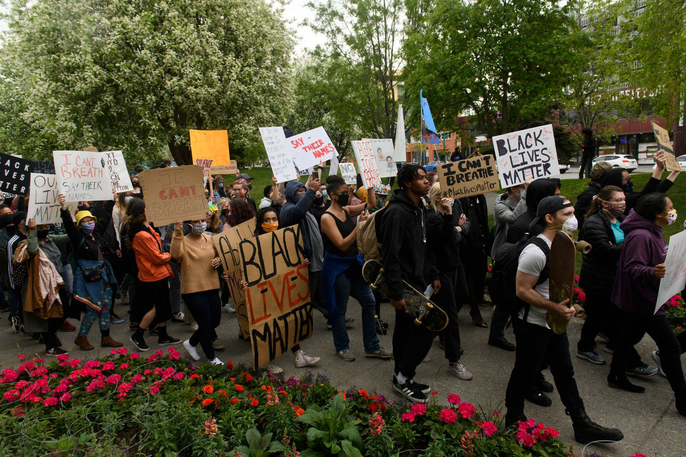 Marchers head from Town Square to 6th Avenue. (Marc Lester / Anchorage Daily News)