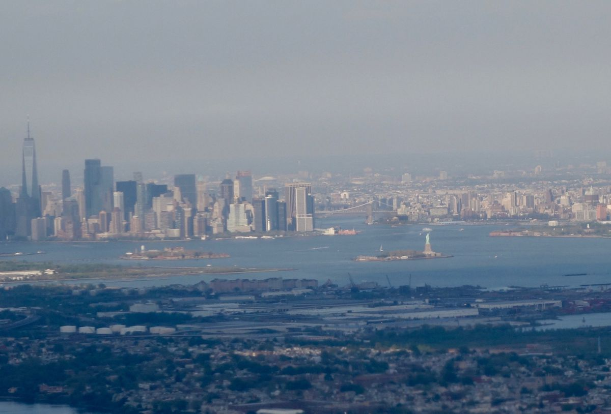A view of Manhattan, Brooklyn and the Statue of Liberty from the window seat of a flight from Newark to Seattle. (Ned Rozell)