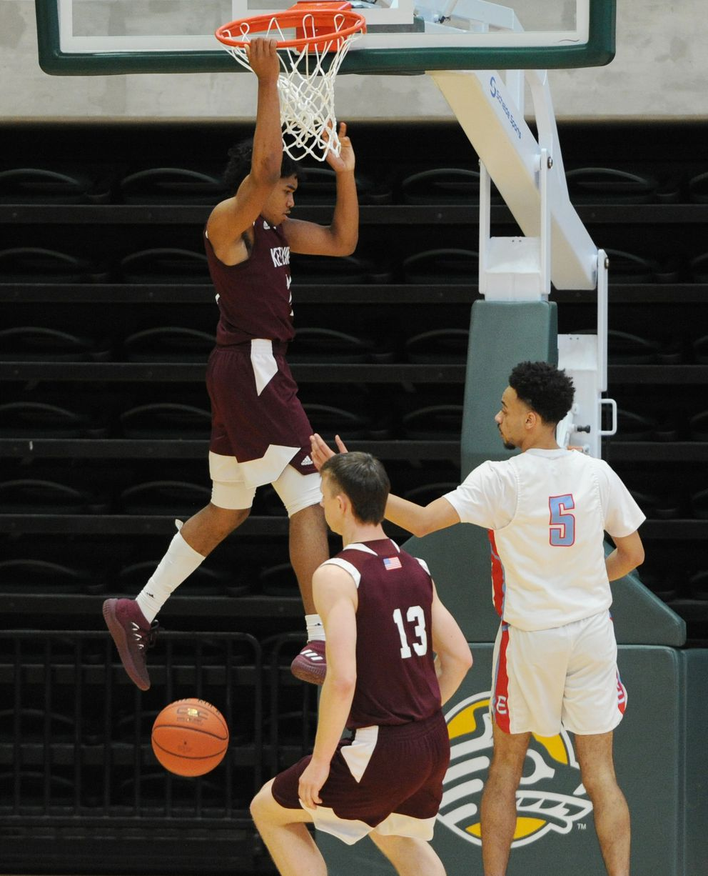 Chris Lee of Ketchikan dunks the ball during the Kings' 60-58 upset victory over East. (Bill Roth / ADN)