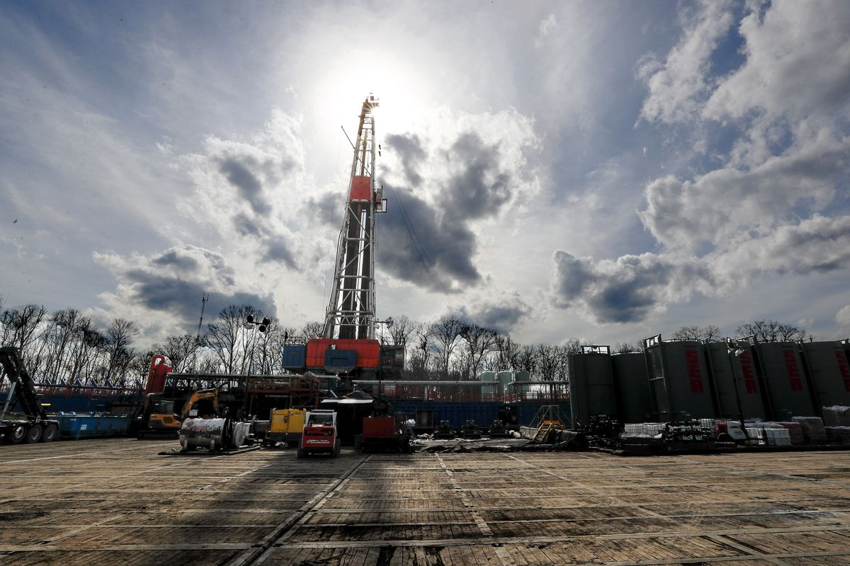 In this March 12, 2020, file photo, the sun shines through clouds above a shale gas drilling site in St. Mary's, Pa. (AP Photo/Keith Srakocic, File)