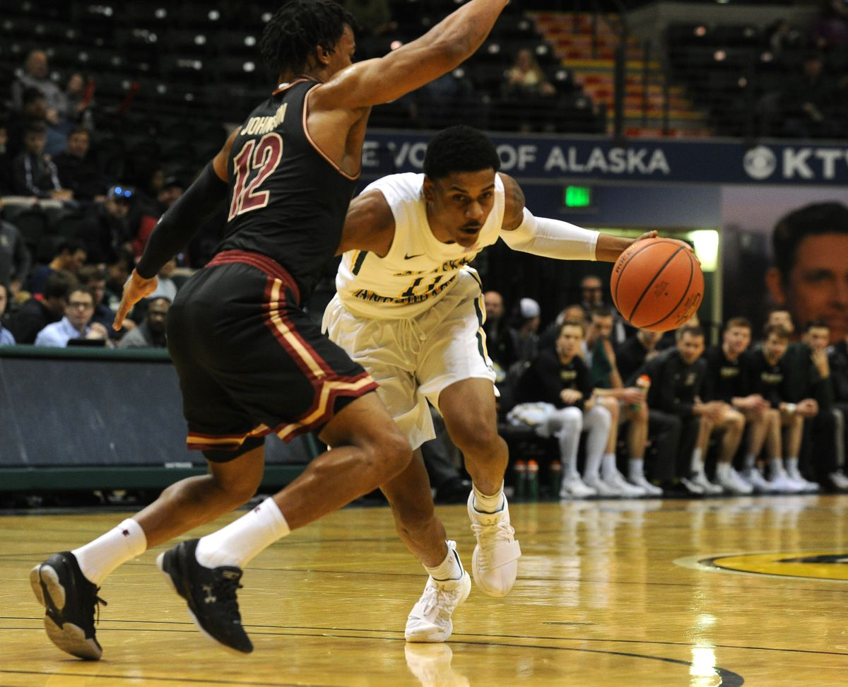 D.J. Ursery of UAA, right, was a second-team selection on the GNAC all-conference team announced Tuesday. (Bob Hallinen / ADN)