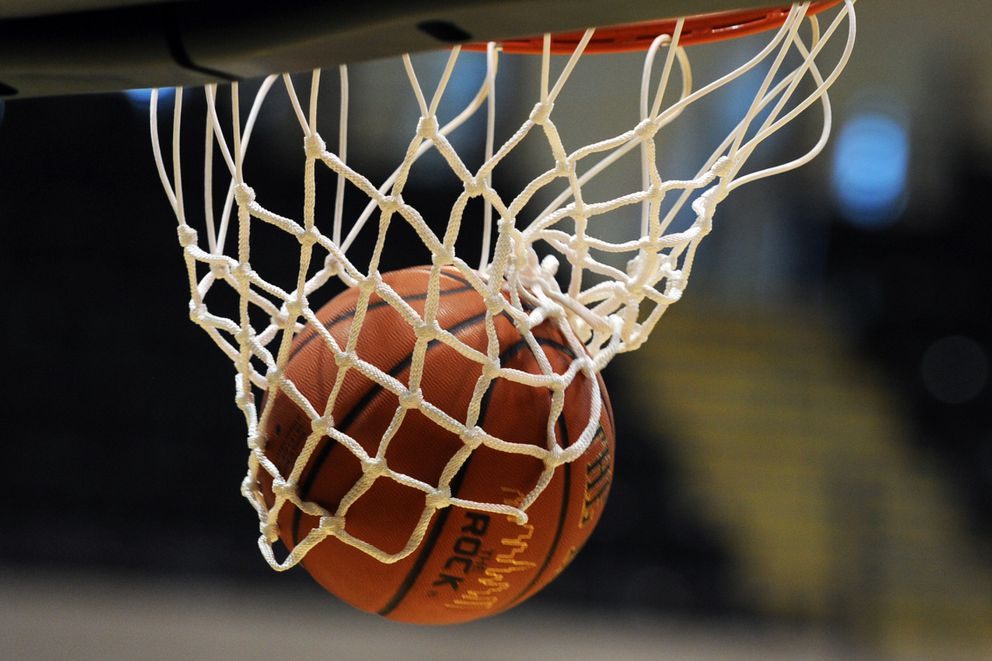 A free throw settles into the net during 2A boys action the 2017 March Madness Alaska state basketball tournament on Thursday, March 16, 2017, at UAA. (Erik Hill / Alaska Dispatch News)