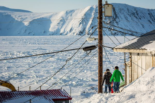 Children navigate a steep and slippery path among houses in Little Diomede on March 13, 2013. (Loren Holmes / ADN)