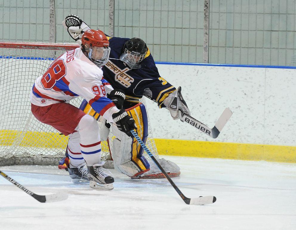 Nick Eddens scoops up the rebound in front of Bartlett goalie Hayden Laflamme. (Bob Hallinen / ADN)