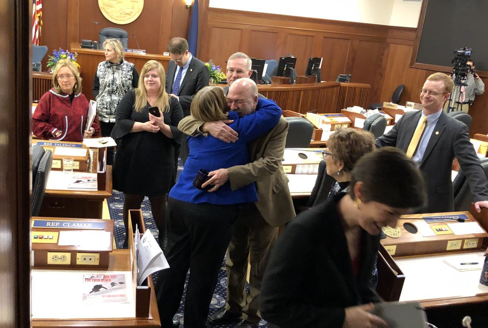 Rep. Adam Wool, D-Fairbanks, embraces Rep. Tammie Wilson, R-North Pole, after she announced her resignation from the Alaska House of Representatives on Friday. (James Brooks / ADN)