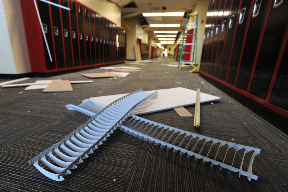Parts of light fixtures and ceiling tiles came to rest on a hallway floor at Houston Middle School during the 7.0 earthquake. (Bill Roth / ADN)