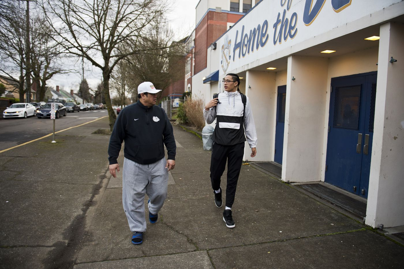 Roland Hepa, left, picks up his son, Kamaka, from basketball practice on Feb. 15, 2018, in Portland, Oregon. (Marc Lester / ADN)