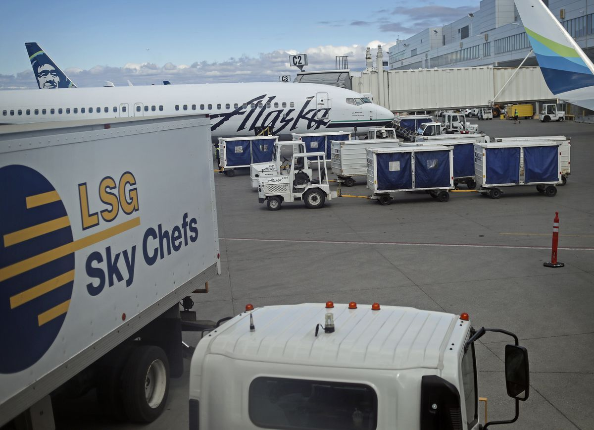 Luggage is loaded onto an Alaska Airlines jet before it takes off from the Ted Stevens Anchorage International Airport on Sunday, May 16, 2021. (Emily Mesner / ADN)
