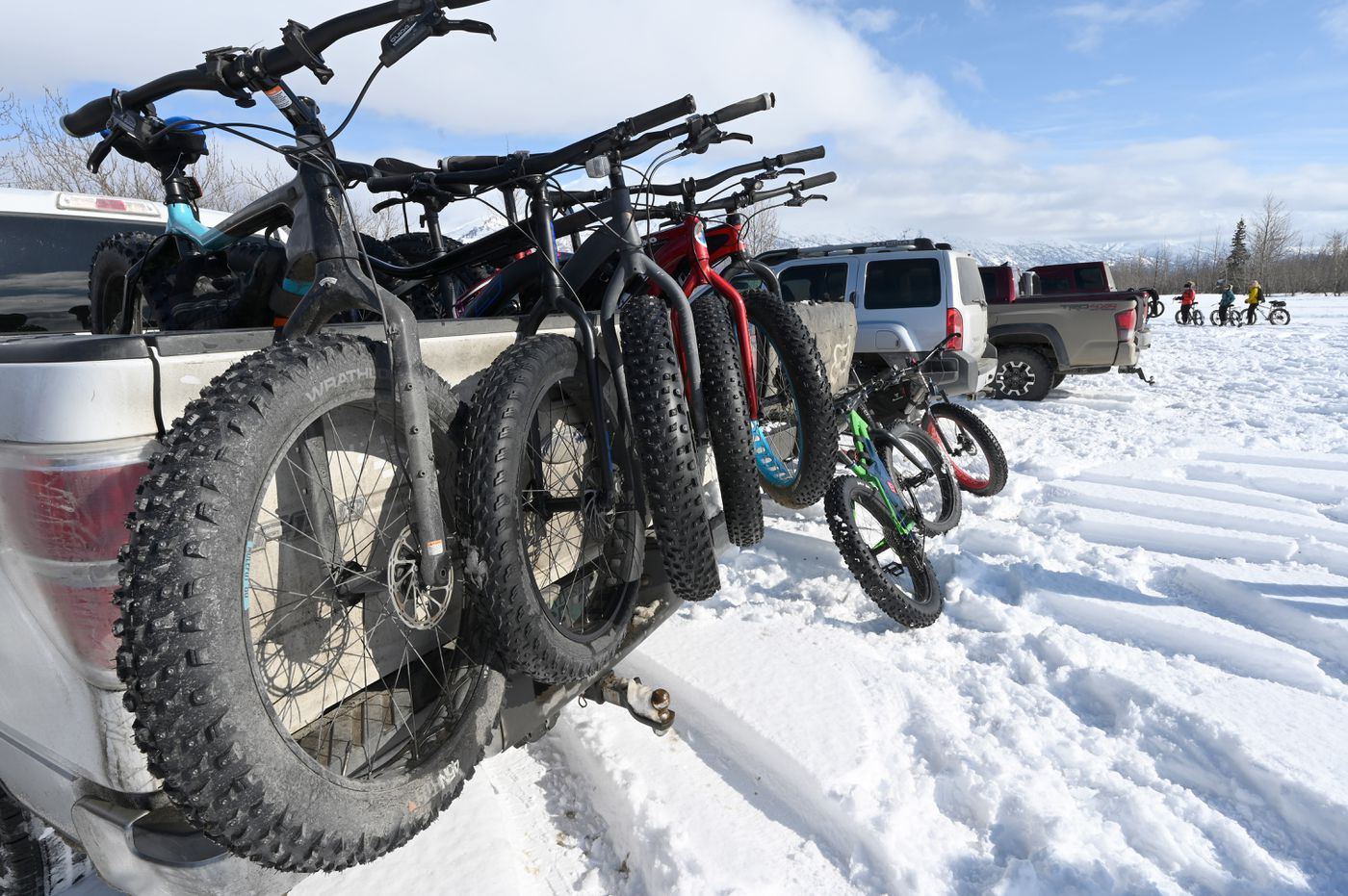Bikes are ready to be offloaded in the Knik Glacier Tours parking area. This is beginning of the 10-mile trail to the Knik Glacier Saturday, March 27, 2021. (Anne Raup / ADN)