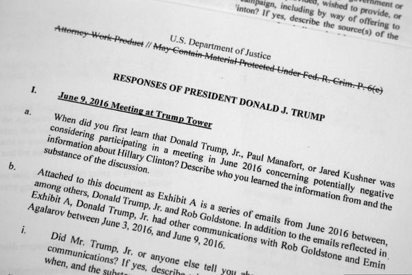 Special Counsel Robert Mueller's redacted report that includes written answers from President Donald Trump as released on Thursday, April 18, 2019, is photographed in Washington. (AP Photo/Jon Elswick)