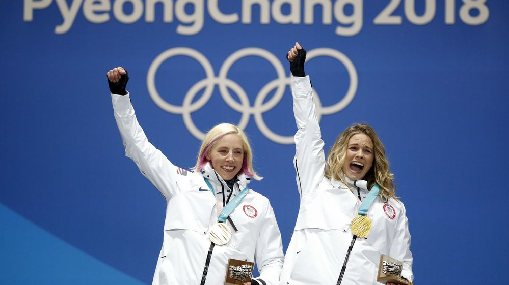 Gold medalists Kikkan Randall and Jessica Diggins of the U.S. on the podium after the women's freestyle team spring on Feb. 22, 2018, in Pyeongchang, South Korea. REUTERS/Kim Hong-Ji