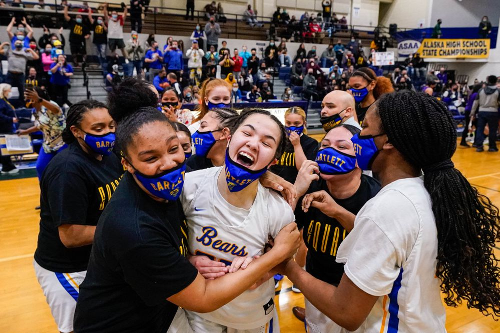 The Bartlett girls basketball team reacts after winning the 4A state championship basketball game against Lathrop on Saturday, March 27, 2021 in Palmer. Bartlett won 47-46 in overtime. (Loren Holmes / ADN)