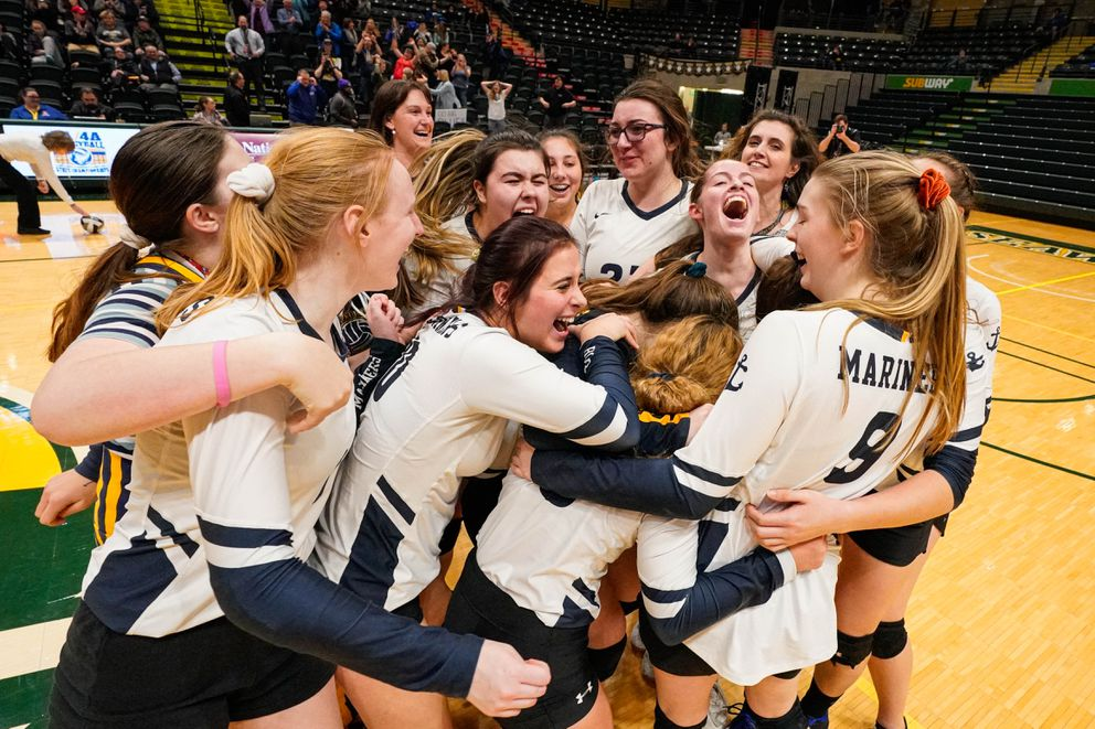 Homer celebrates after defeating Kenai Central for the Class 3A state volleyball championship at the Alaska Airlines Center. (Loren Holmes / ADN)