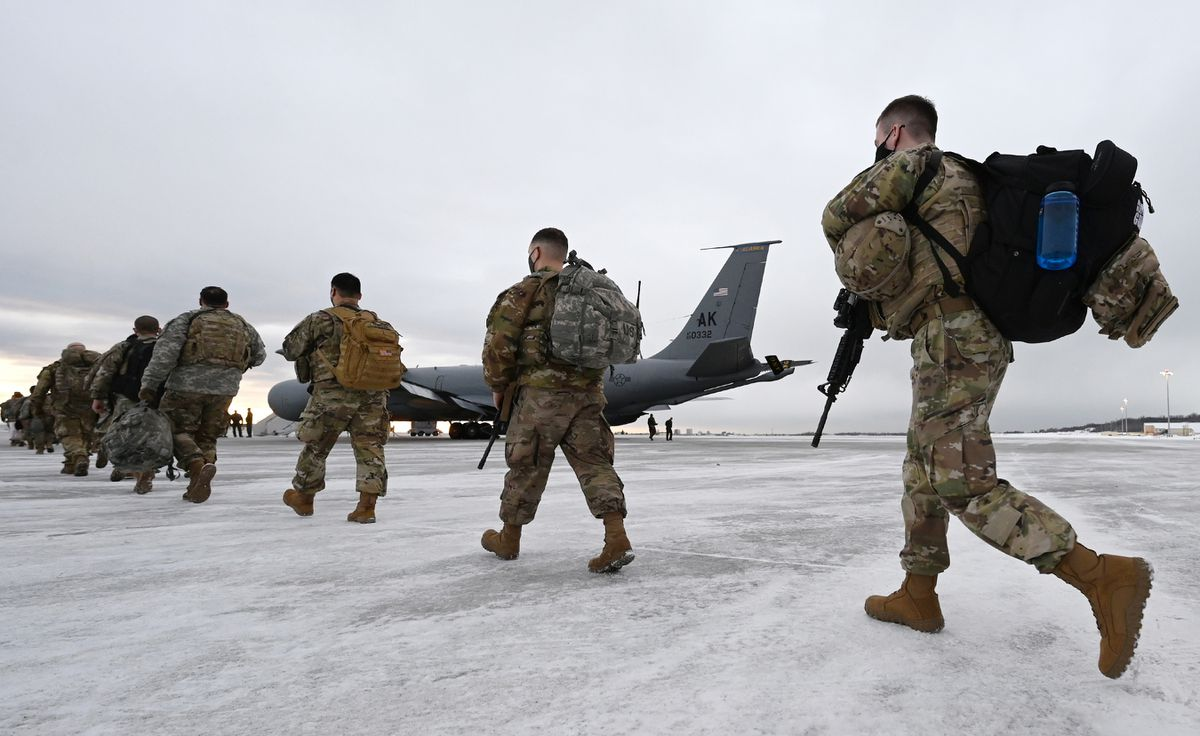 Airmen and Soldiers from the Alaska National Guard prepare to depart from Joint Base Elmendorf-Richardson on Sunday, Jan. 17, 2021, to assist with Wednesday's inauguration of President-elect Joe Biden in Washington, D.C. Approximately 80 Alaska Guardsmen volunteered and most of them will be transported by a KC-135 Stratotanker from the Alaska Air National Guard's 168th Wing at Eielson Air Force Base on a direct seven-hour flight to Joint Base Andrews in Maryland. The flight was delayed until Monday. (Bill Roth / ADN)