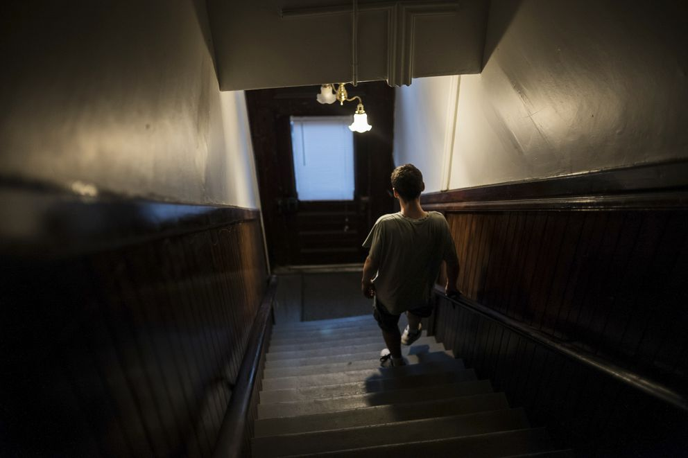 Patrick Griffin, who is addicted to heroin and fentanyl, leaves his mother's apartment, in Manchester, N.H., June 19, 2017. (Todd Heisler/The New York Times)